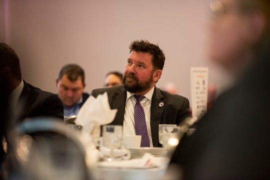 Marysville Mayor Dan Damman listens while developer Jeff Katofsky shares his plans for the site of the former DTE Energy plant in Marysville at the annual State of the County address Friday, March 22, 2019 at Alexander's in Marysville.