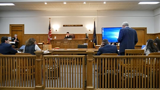 From left: Putnam County Assistant District Attorneys Larry Glasser and Chan Krauss, defense attorneys John Ingrassia and Benjamin Ostrer (standing), and Nicole Addimando in Dutchess County Court before Judge Edward McLoughlin on March 22, 2019.