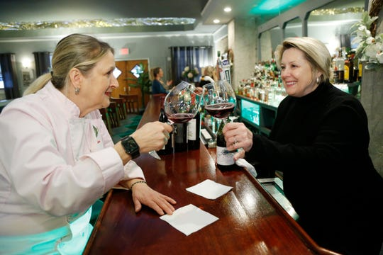 The Would co-owners, from left, Claire Winslow and Debra Dooley sample some red wine at the restaurant's bar in Highland on March 21, 2019.