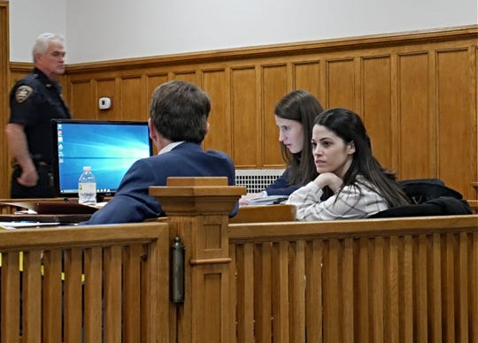 Nicole Addimando talks to members of her defense team in Dutchess County Court on March 21, 2019.
