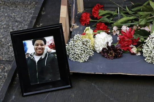 A photo of Antwon Rose II sits with a memorial display for Rose II in front of the Allegheny County courthouse on the second day of the trial for Michael Rosfeld, a former police officer in East Pittsburgh, Pa., Wednesday, March 20, 2019. Rosfeld is charged with homicide in the fatal shooting of Antwon Rose II as he fled during a traffic stop on June 19, 2018. (AP Photo/Gene J. Puskar)