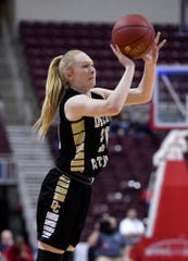 Delone Catholic's Brooke Lawyer shoots for three against Dunmore during the PIAA Class 3-A girls' basketball championship, Thursday, March 21, 2019. 