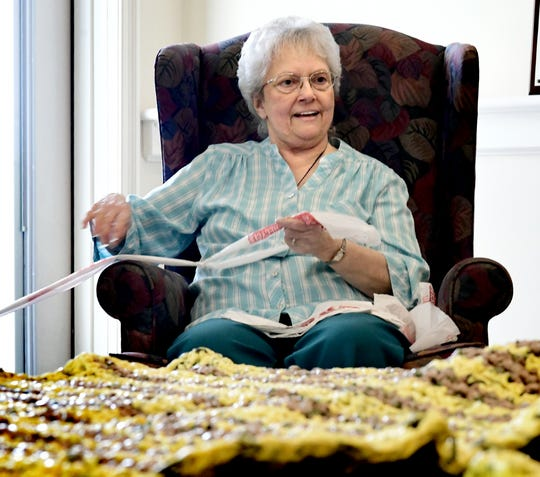 Normandie Ridge resident Betty Shive talks with other Plarn People members while crocheting plastic yarn during a gathering at the residence in West Manchester Township Monday, March 18, 2019. The group, which has met monthly since November, is making sleeping mats from donated plastic shopping bags. The mats are being donated to LifePath Christian Ministries and York Helping Hands. Founder Jinny Foor said each mat requires about 700 bags and 40-50 hours of labor to complete. Bill Kalina photo