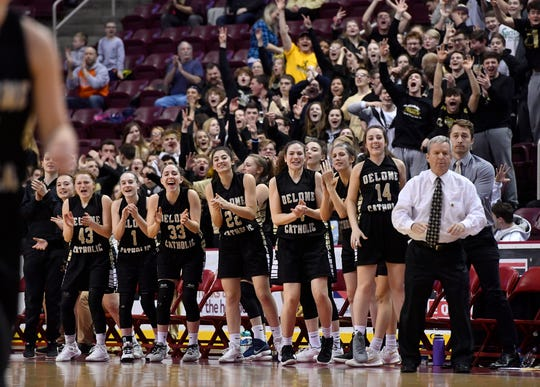 The Delone Catholic bench reacts as the Squirettes open their lead on Dunmore during the PIAA Class 3-A girls' basketball championship, Thursday, March 21, 2019. 