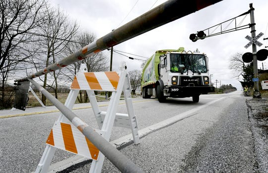 A garbage truck turns around after encountering a roadblock on Trinity Road near the West Manchester and North Codorus Township border South Branch of the Codorus Creek began rising over the road Friday, March 22, 2019. Several roads in York County were closed due to flooding Friday. Bill Kalina photo