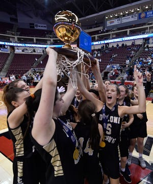 The Delone Catholic girls' basketball team celebrates its PIAA Class 3-A state championship in March. Under a proposed bill, Delone would no longer compete in the PIAA playoffs alongside public schools. Instead, there would be separate state playoffs for public and private schools. The two state champs would then face off in a single game.