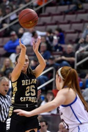 Delone Catholic's Camryn Felix shoots over a Dunmore defender during the PIAA Class 3-A girls' basketball championship, Thursday, March 21, 2019. John A. Pavoncello photo