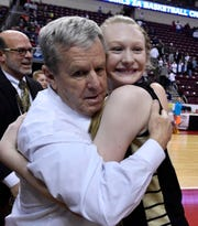 Delone Catholic head coach Gerry Eckenrode hugs his leading scorer, Brooke Lawyer, after the Squirettes won the PIAA Class 3-A state title on Thursday.