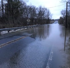 Flooded, closed roads as rain tapers off Friday, high wind gusts to settle in