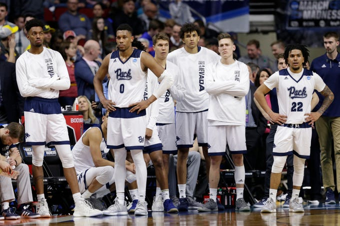 Nevada payers watch the last seconds of the second half of a first round men's college basketball game against Florida in the NCAA Tournament in Des Moines, Iowa, Thursday, March 21, 2019. (AP Photo/Nati Harnik)