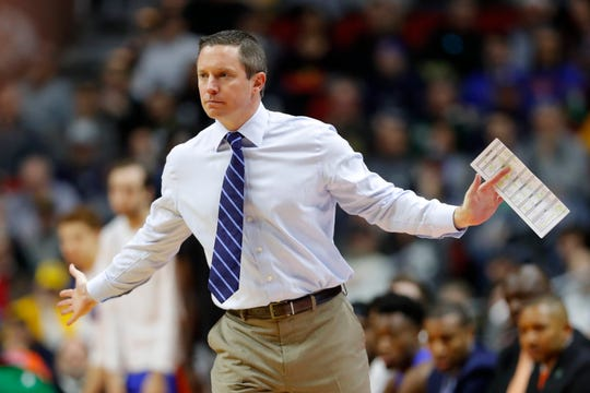 Florida coach Mike White directs his team's game against Nevada in the first round of the 2019 NCAA tournament.