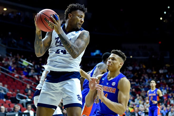 Nevada senior Jordan Caroline (24) gets a rebound over Florida's Keyontae Johnson during the team's NCAA Tournament game on Thursday.