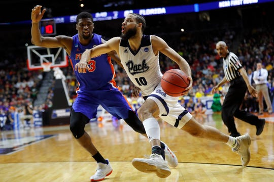 Nevada forward Caleb Martin drives past Florida center Kevarrius Hayes during a first-round NCAA Tournament game on March 21.