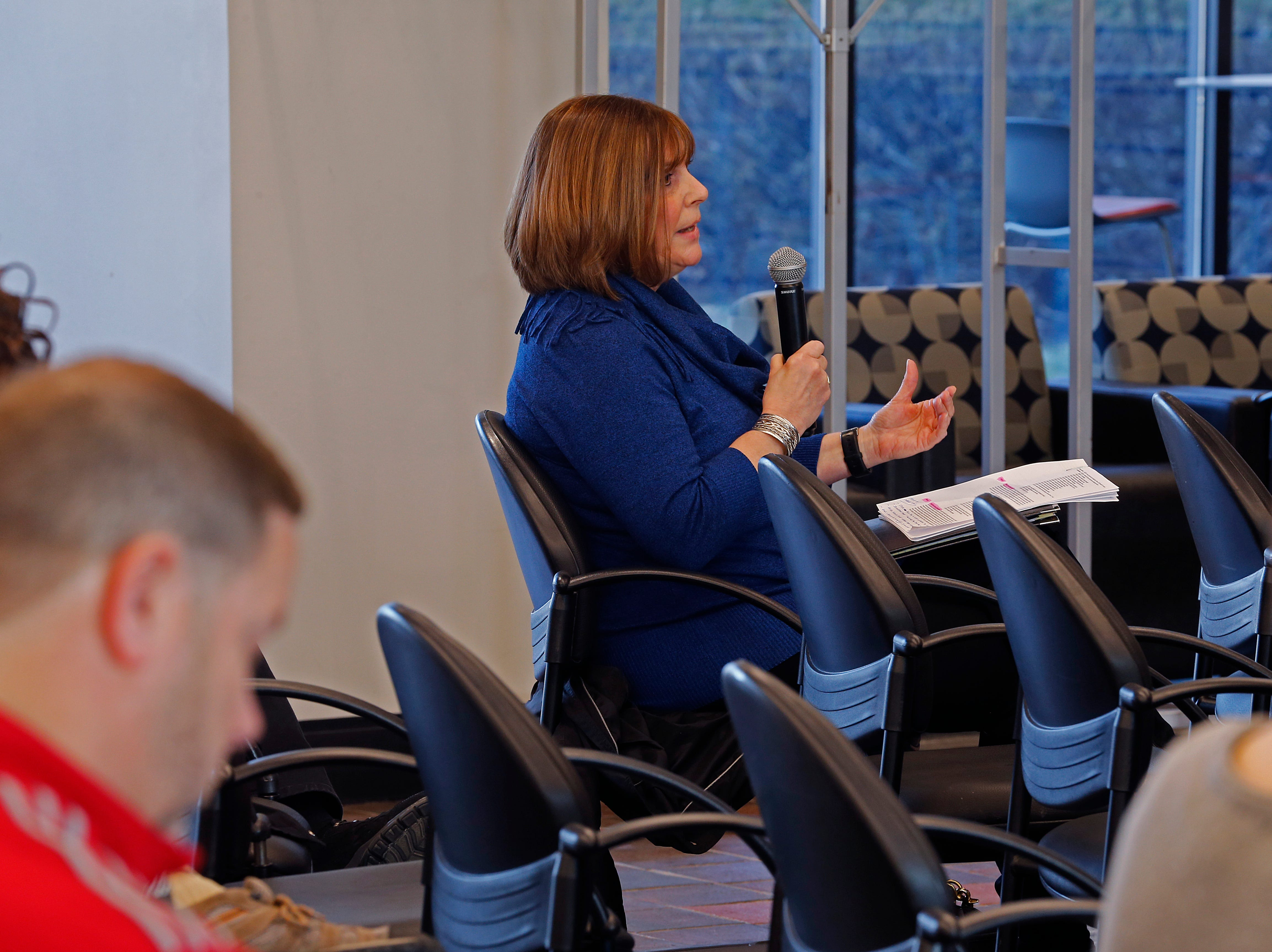 Mary Walker of the Wayne County Convention & Tourism Bureau asks a question during the Legislative Forum on Friday, March 22, 2019, at IU East.