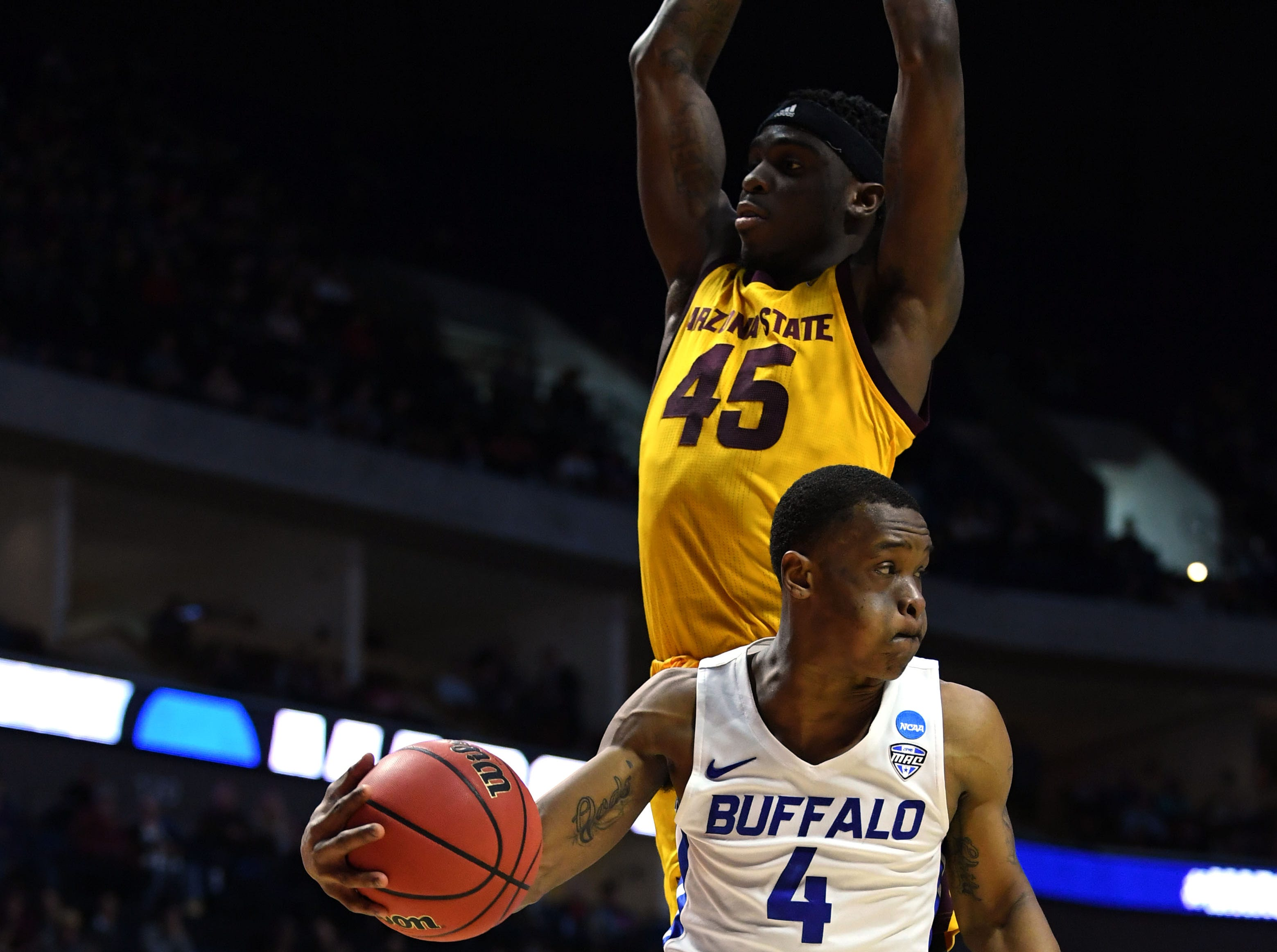 TULSA, OKLAHOMA - MARCH 22:  Davonta Jordan #4 of the Buffalo Bulls drives against Zylan Cheatham #45 of the Arizona State Sun Devils during the first half of the first round game of the 2019 NCAA Men's Basketball Tournament at BOK Center on March 22, 2019 in Tulsa, Oklahoma. (Photo by Harry How/Getty Images)