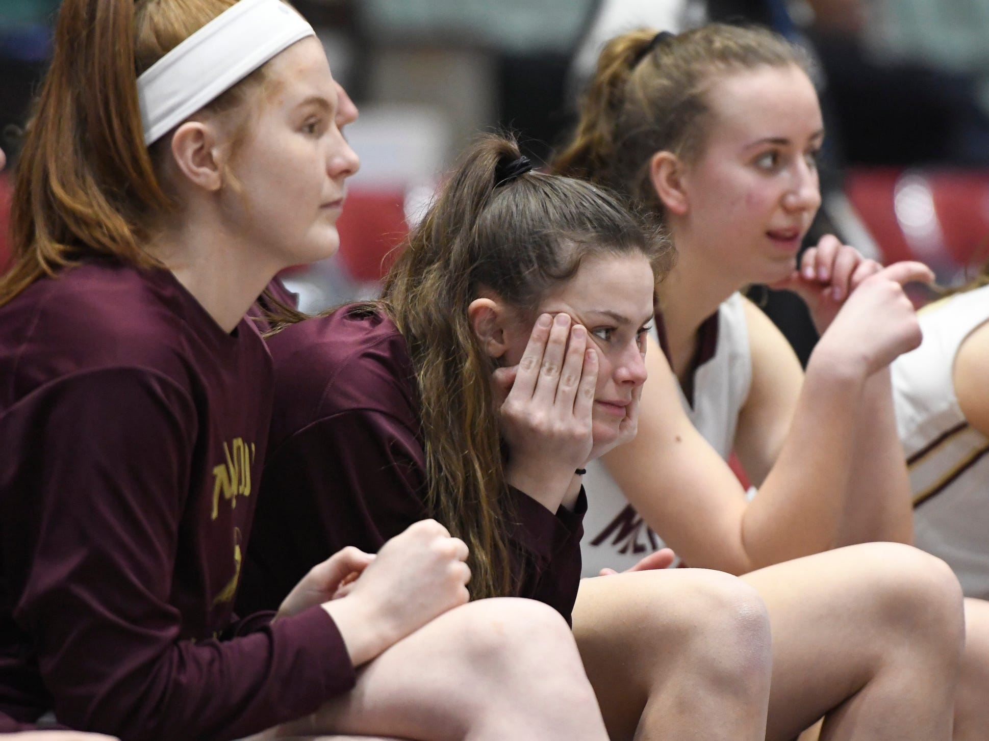 The Pittsford Mendon bench was tense as the  Vikings fell behind by 10 points in the Federation Tournament of Champions semifinal against James Madison at Cool Insuring Arena on Friday, Mar. 23, 2019, in Glens Falls. Mendon rallied to win, 49-43.