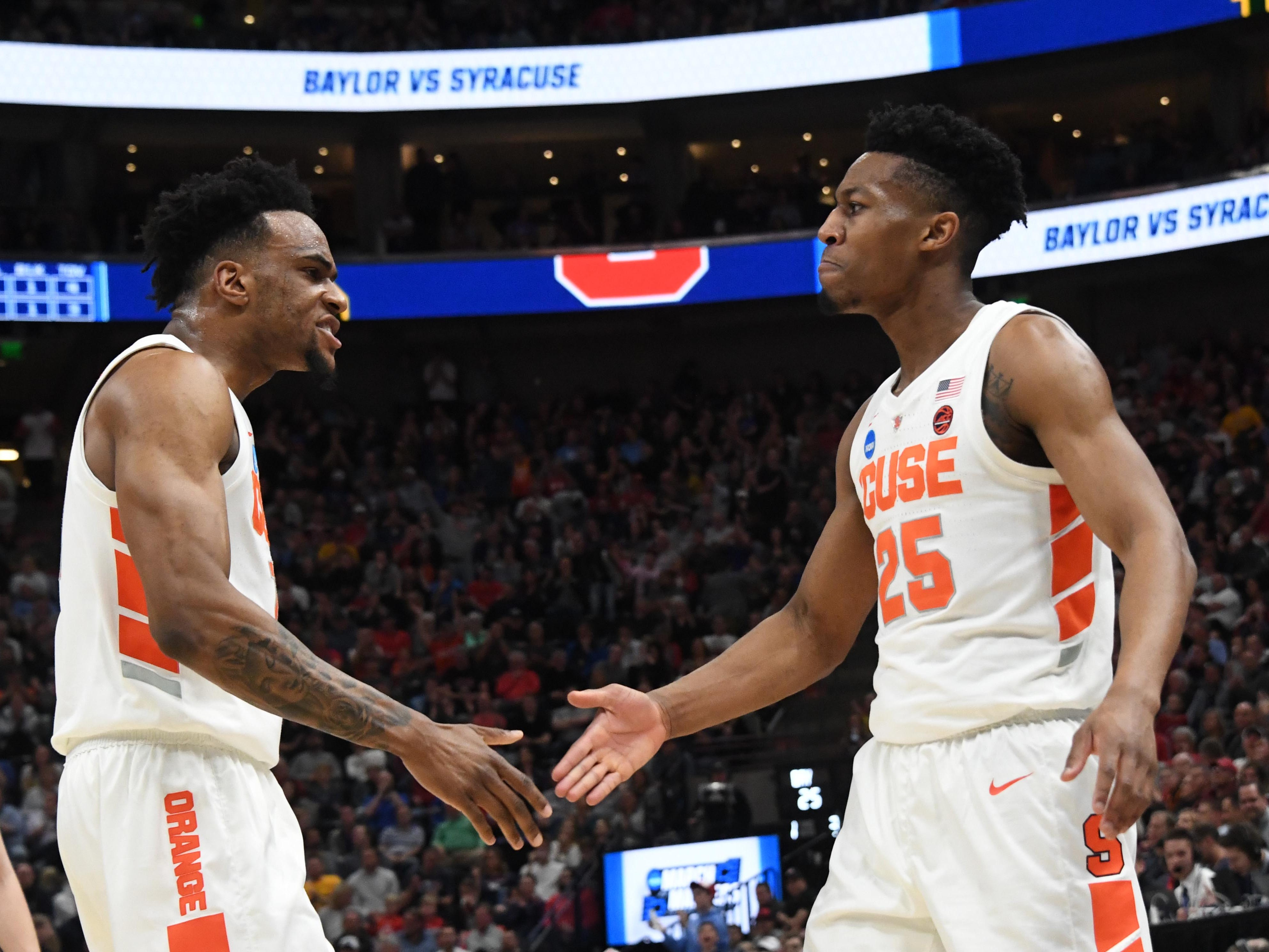 Syracuse guard Tyus Battle (25) celebrates with Oshae Brissett during the first half against Baylor.