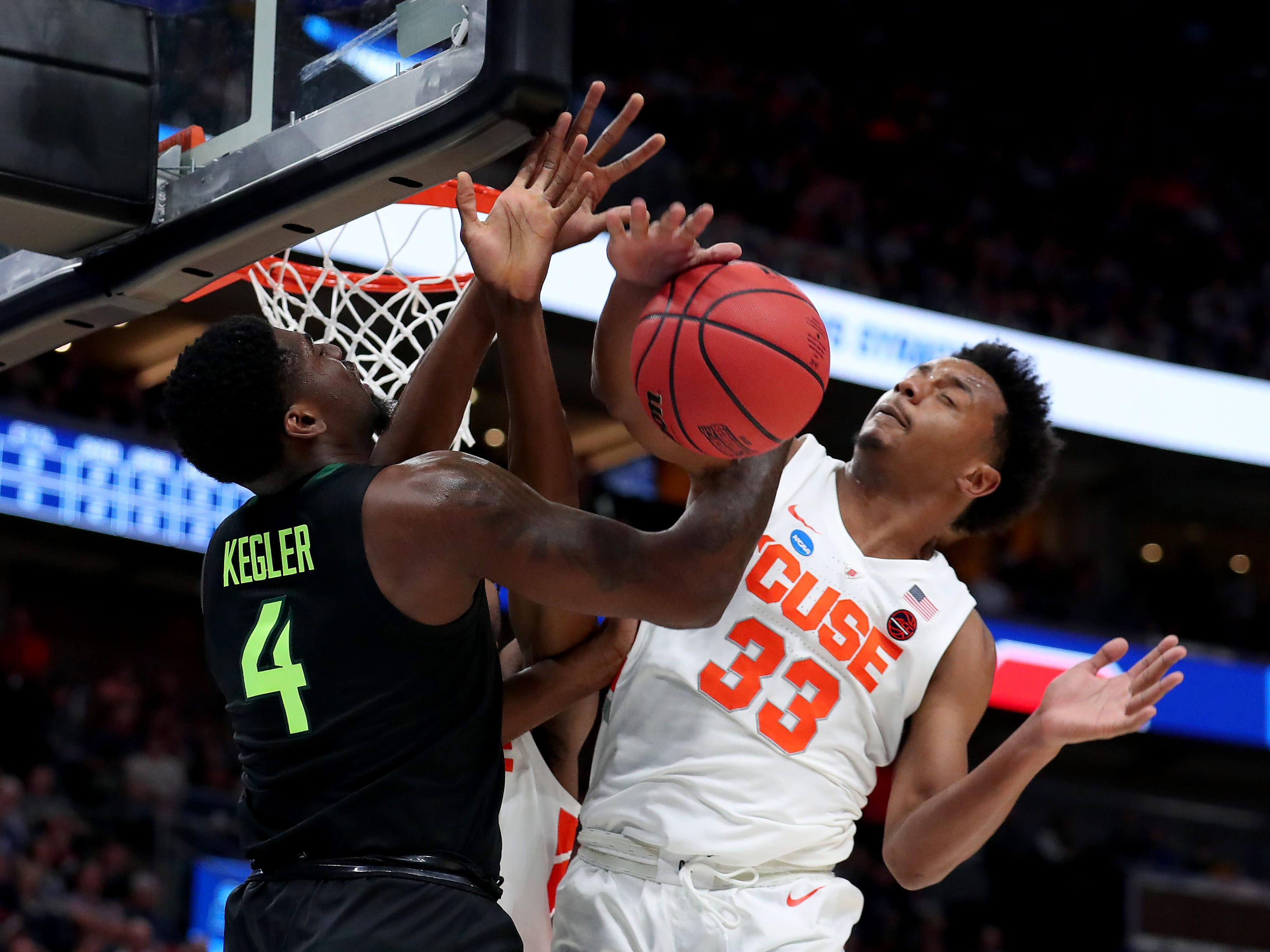 Mario Kegler of the Baylor Bears defends  against Elijah Hughes of the Syracuse Orange during the first half in the first round of the 2019 NCAA Men's Basketball Tournament at Vivint Smart Home Arena on March 21, 2019 in Salt Lake City, Utah.