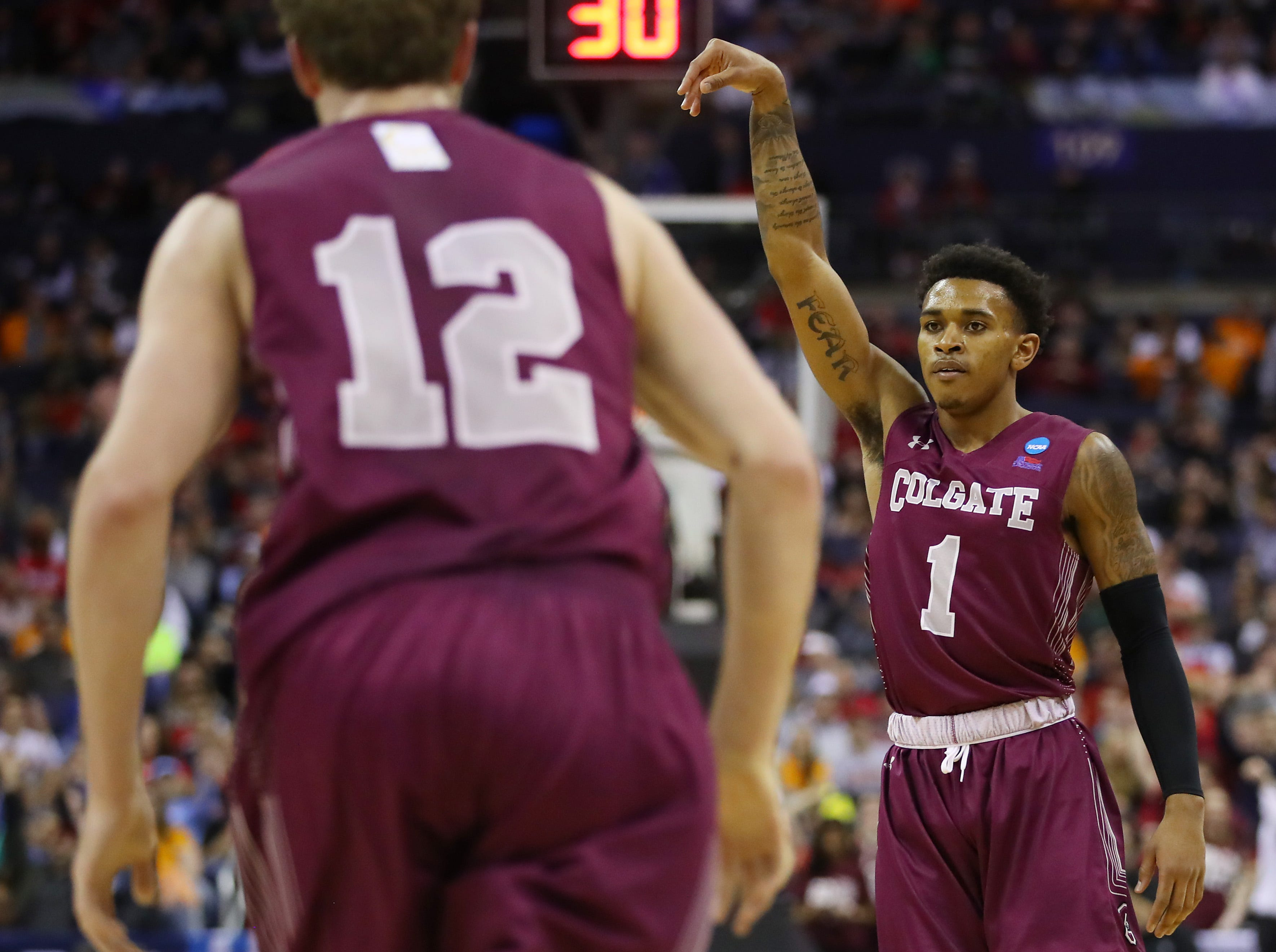 COLUMBUS, OHIO - MARCH 22: Jordan Burns #1 of the Colgate Raiders reacts during the first half against the Tennessee Volunteers in the first round of the 2019 NCAA Men's Basketball Tournament at Nationwide Arena on March 22, 2019 in Columbus, Ohio. (Photo by Gregory Shamus/Getty Images)