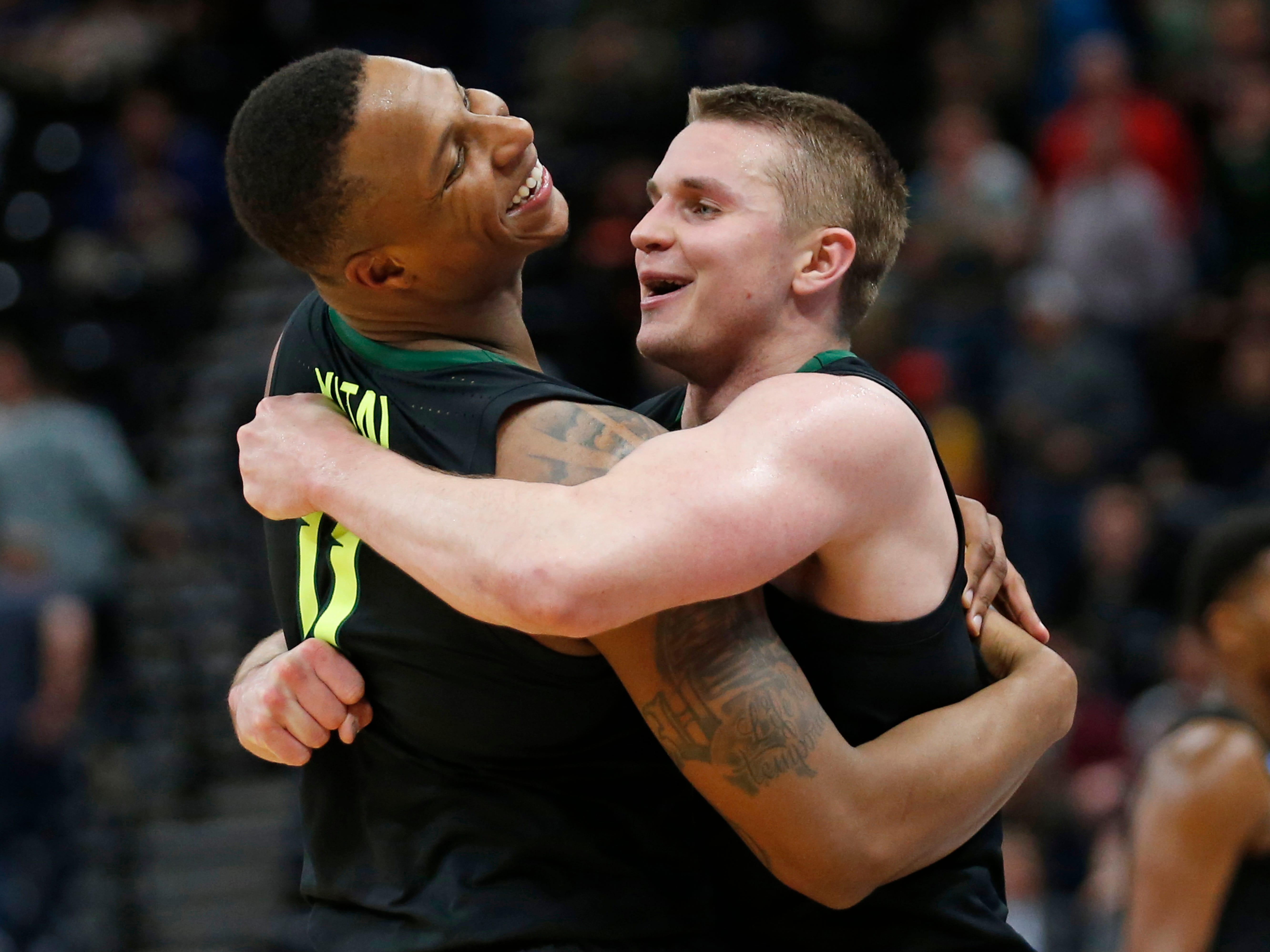 Baylor guards Makai Mason, right, and Mark Vital (11) hug following the team's 78-69 win over Syracuse in a first-round game in the NCAA men's college basketball tournament Thursday in Salt Lake City.