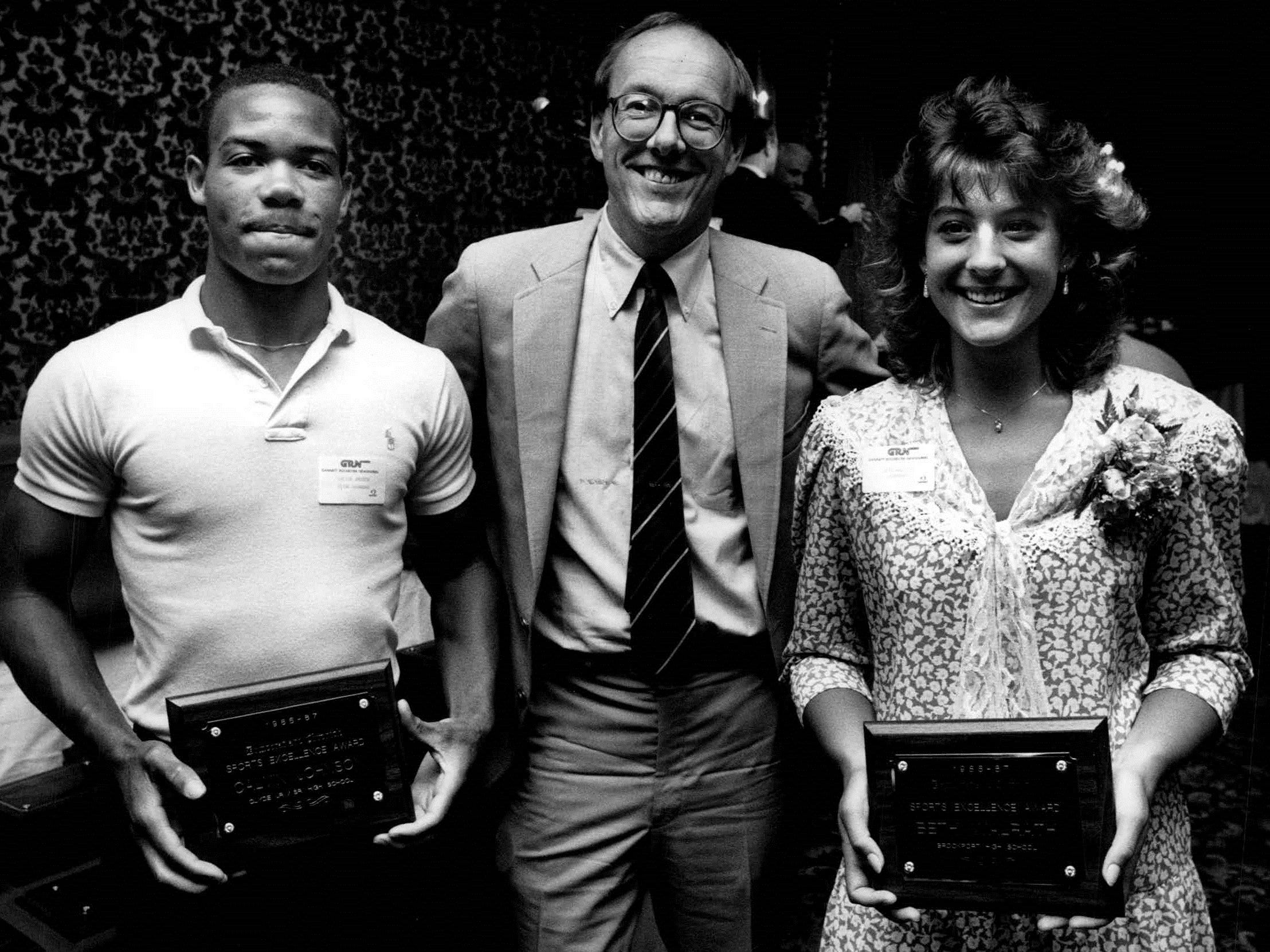 Syracuse University basketball coach Jim Boeheim, center, was the guest speaker at the 1987 Gannett Sports Excellence Awards Dinner. Boeheim is flanked by Calvin Johnson of Clyde-Savannah and Beth Walrath of Brockport at the Mapledale Party House.