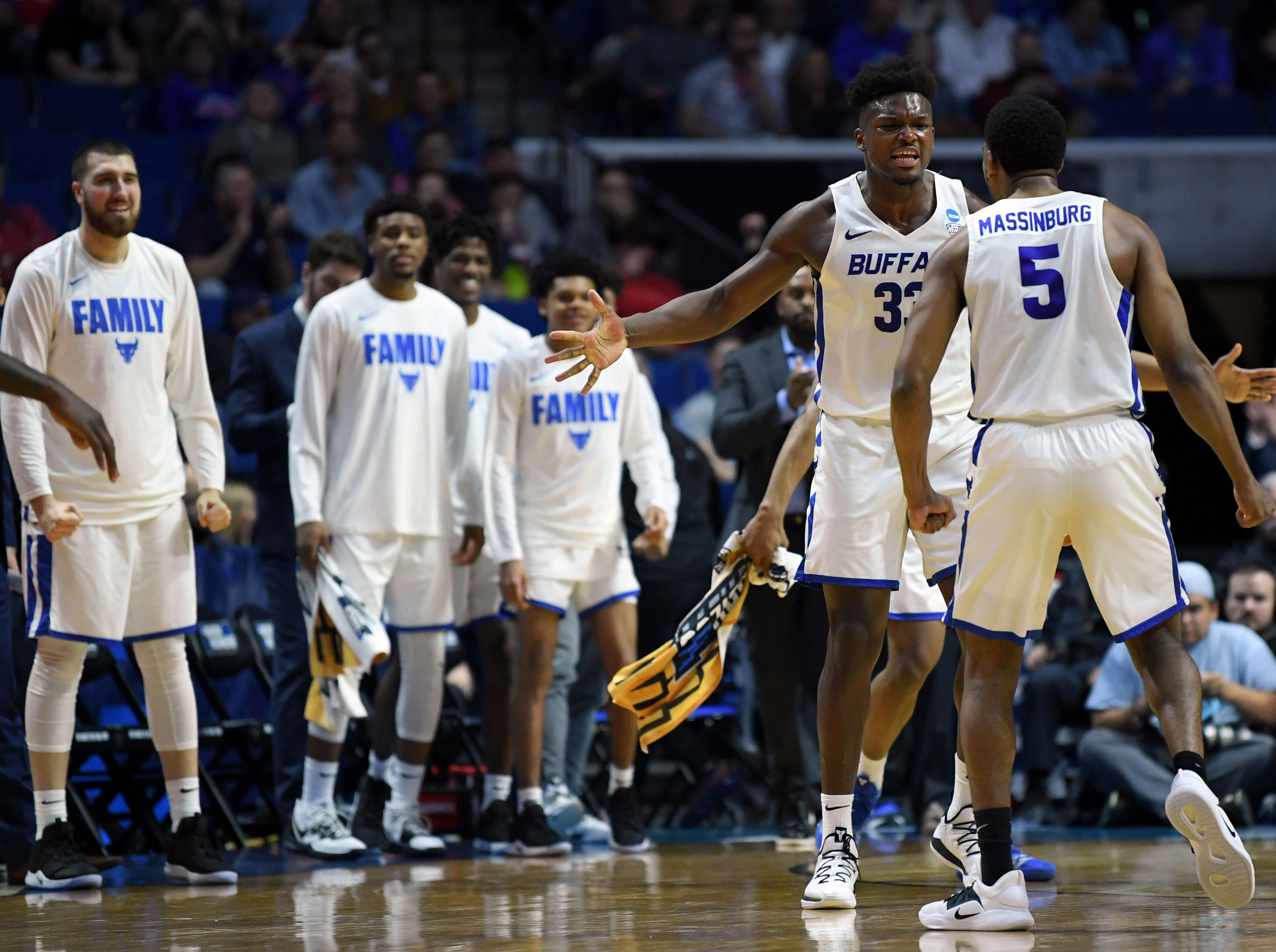 TULSA, OKLAHOMA - MARCH 22:  Nick Perkins #33 and CJ Massinburg #5 of the Buffalo Bulls celebrate after a time out is called during the first half of the first round game of the 2019 NCAA Men's Basketball Tournament against the Arizona State Sun Devils at BOK Center on March 22, 2019 in Tulsa, Oklahoma. (Photo by Harry How/Getty Images)