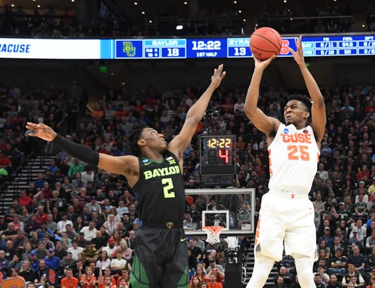 Syracuse  guard Tyus Battle (25) shoots over Baylor Bears guard Devonte Bandoo (2)  during the first half in the first round of the 2019 NCAA Tournament at Vivint Smart Home Arena. Mandatory.