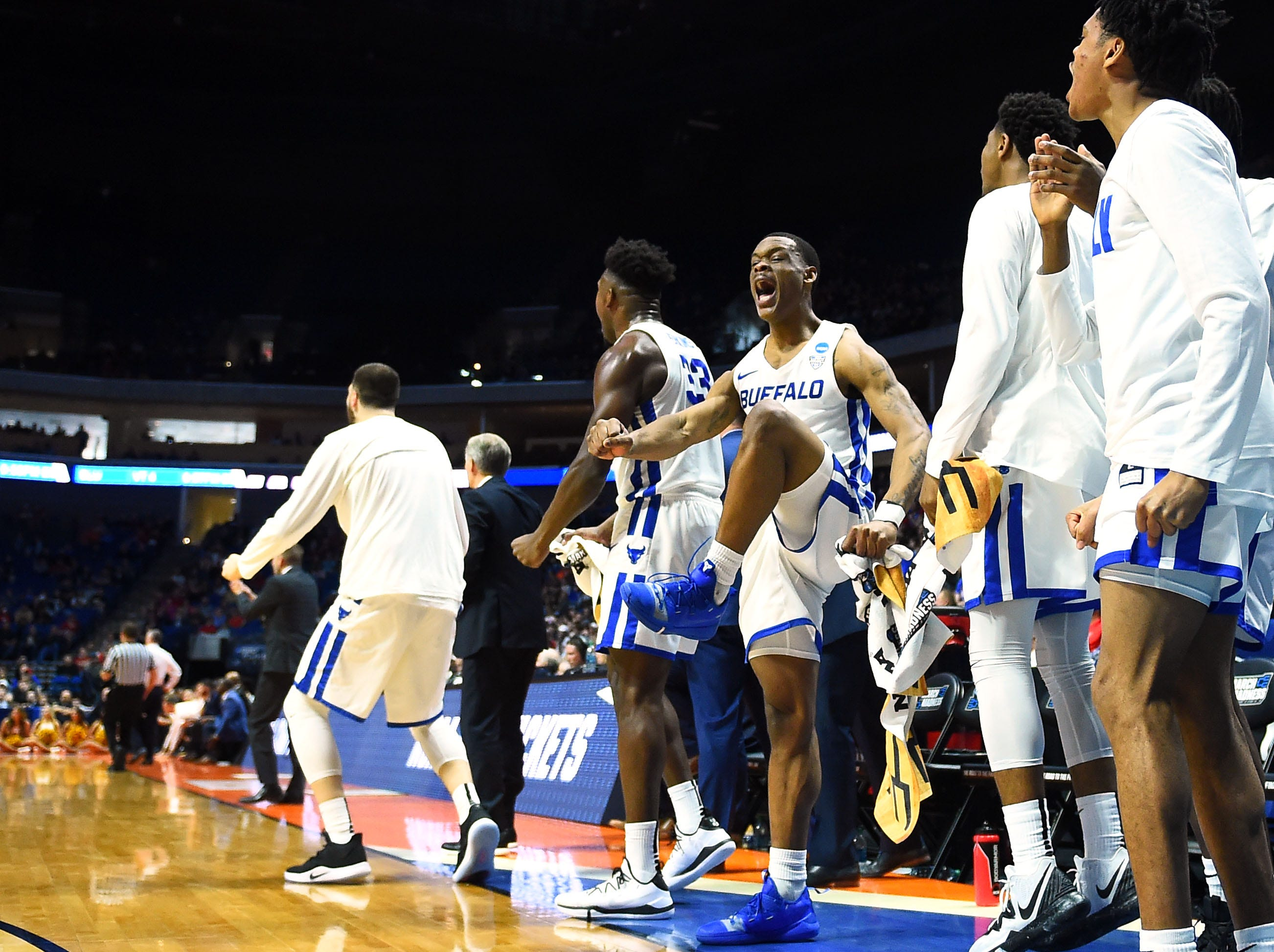 TULSA, OKLAHOMA - MARCH 22:  Davonta Jordan #4 of the Buffalo Bulls celebrates from the bench during the first half of the first round game of the 2019 NCAA Men's Basketball Tournament against the Arizona State Sun Devils at BOK Center on March 22, 2019 in Tulsa, Oklahoma. (Photo by Stacy Revere/Getty Images)