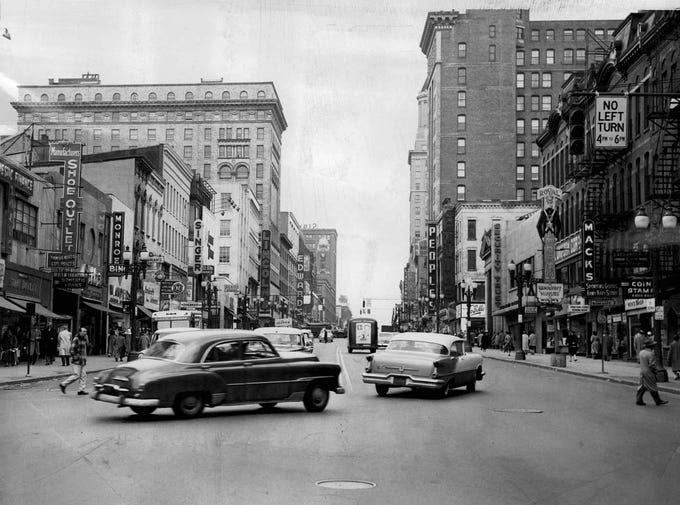 In this photo from March, 1957, cars turn onto East Main Street.