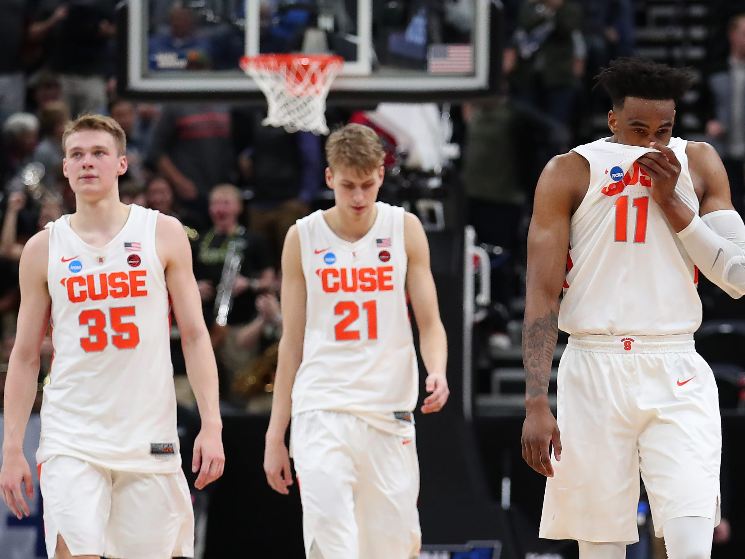 Syracuse's Buddy Boeheim (35), Marek Dolezaj (21) and Oshae Brissett (11) walk off the court after Thursday night's 78-69 loss to Baylor.