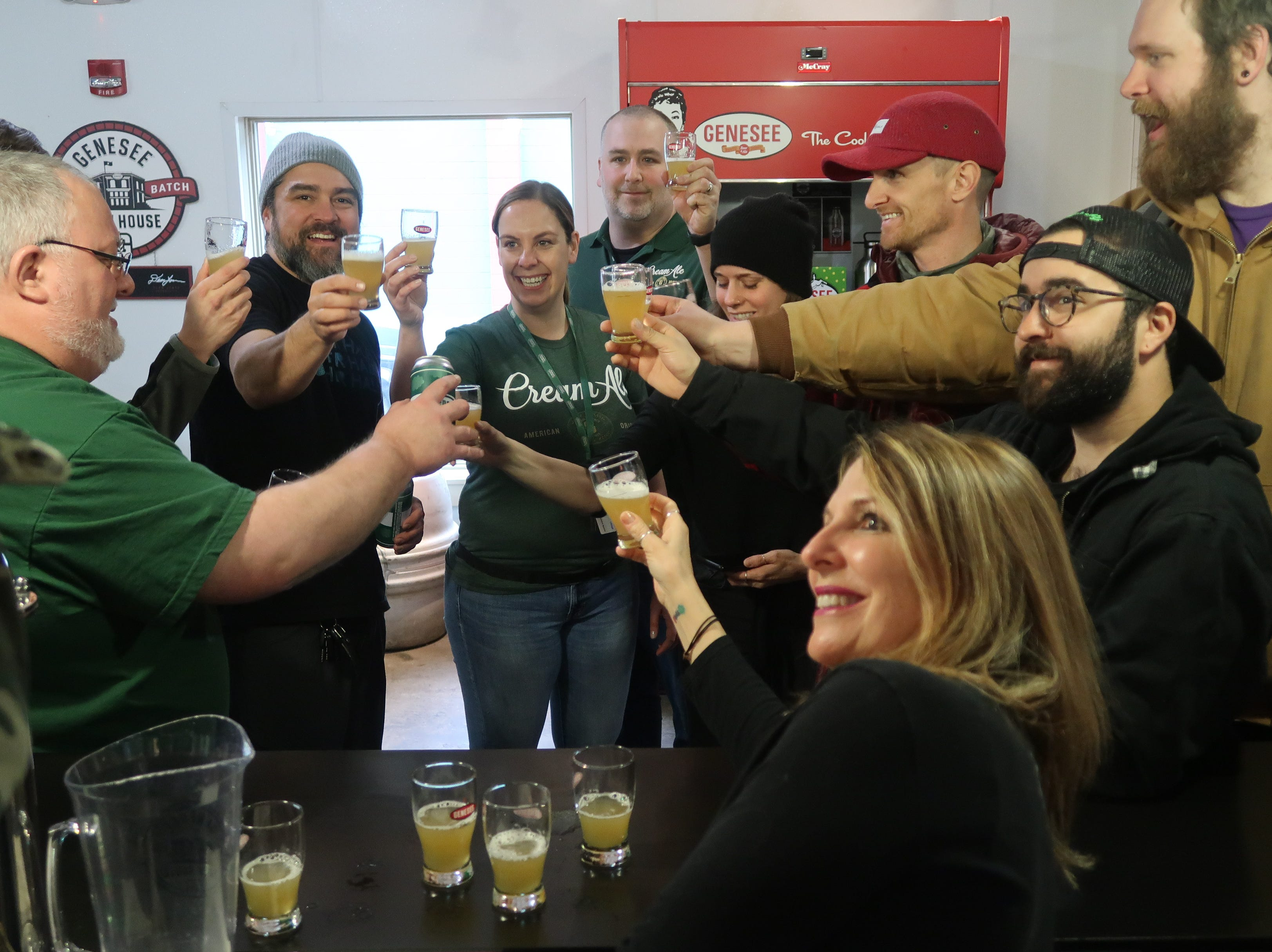 Brewmaster Dean Hones leads Genesee employees and the Other Half crew in a toast of the Genesee Dream Ale before the release Friday.
