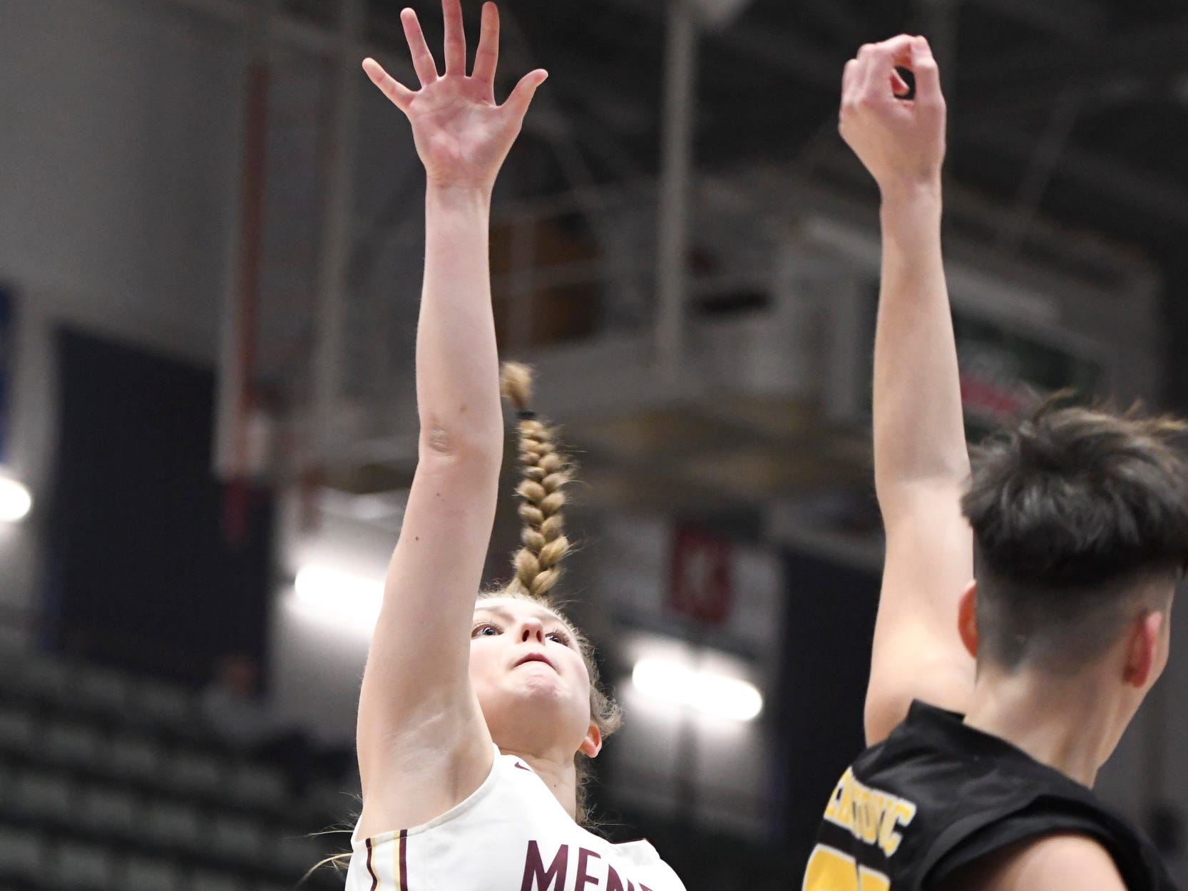 Pittsford Mendon's Courtney Naugle takes a shot over James Madison's Melinda Feratovic during their Girls Class A Federation Tournament of Champions semifinal at Cool Insuring Arena on Friday in Glens Falls.