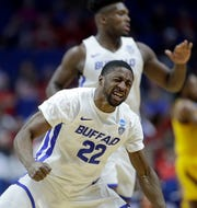 Buffalo's Dontay Caruthers celebrates a teammates basket during the first half of a first round men's college basketball game against Arizona State in the NCAA Tournament Friday, March 22, 2019, in Tulsa, Okla. (AP Photo/Charlie Riedel)