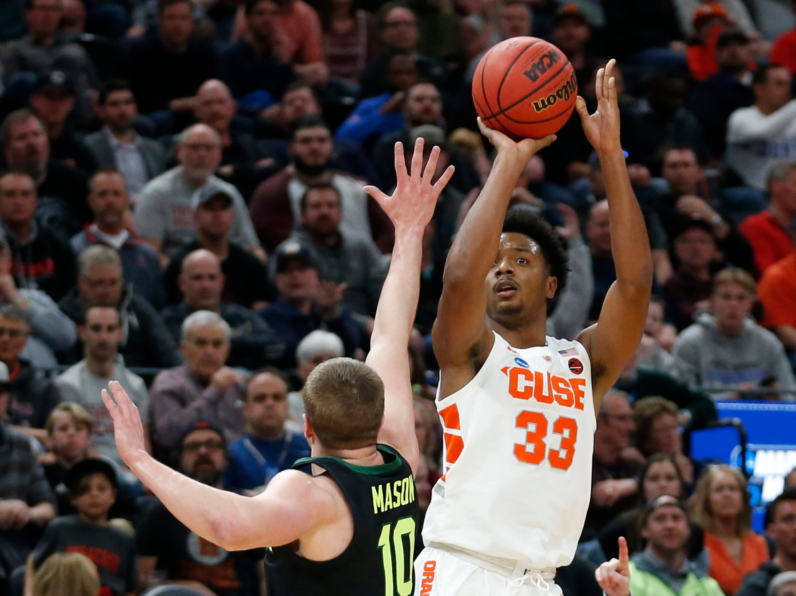 Syracuse forward Elijah Hughes (33) shoots as Baylor guard Makai Mason (10) defends during the first half of a first-round game in the NCAA men's tournament Thursday, March 21, 2019, in Salt Lake City. Hughes scored 18 points in the first half.
