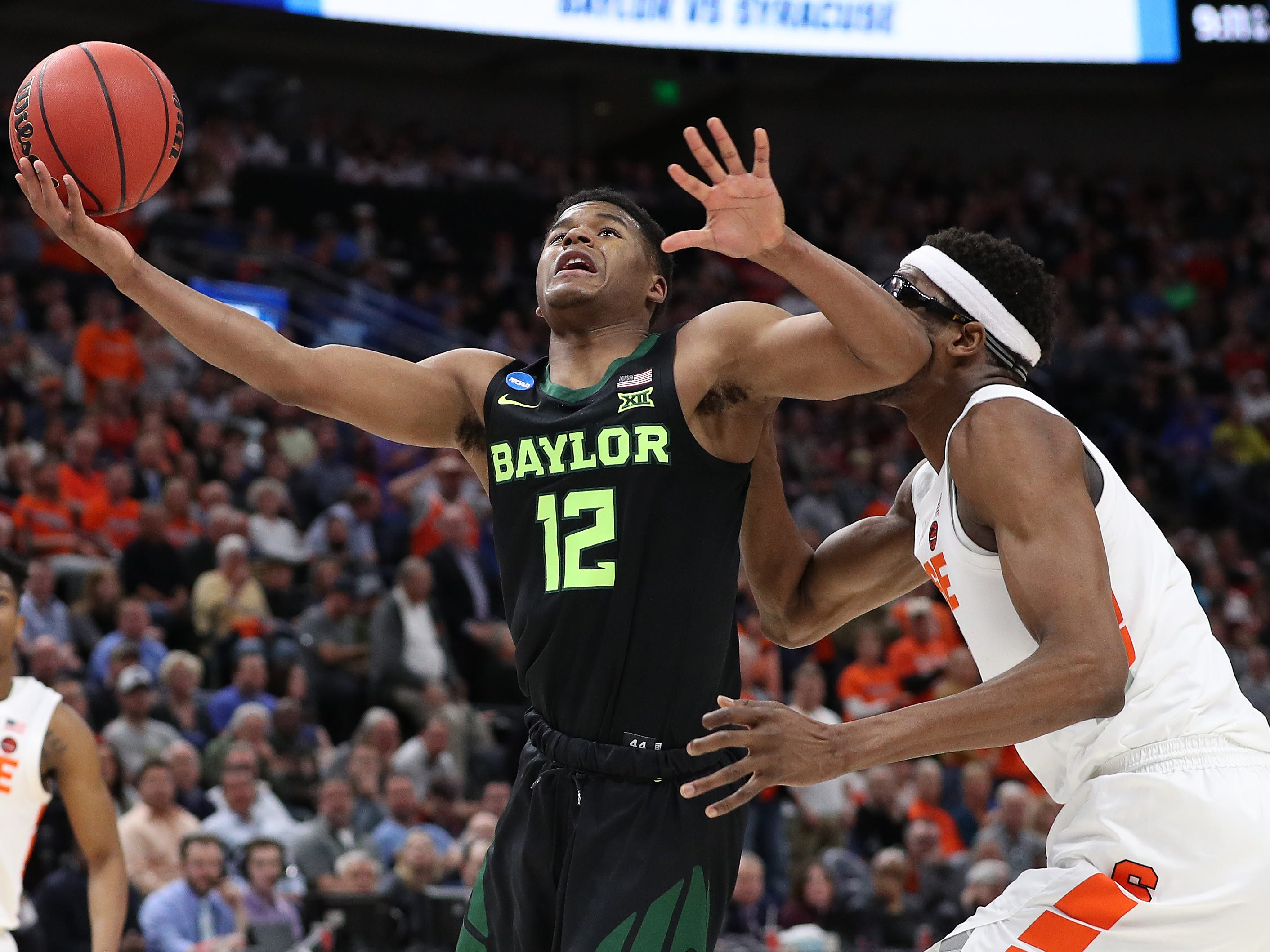 Jared Butler of the Baylor Bears shoots against Paschal Chukwu  of the Syracuse Orange during the second half.
