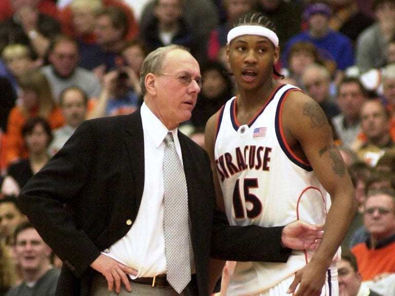 Syracuse's Carmelo Anthony talks with coach Jim Boeheim during a March 9, 2003 game against Rutgers.