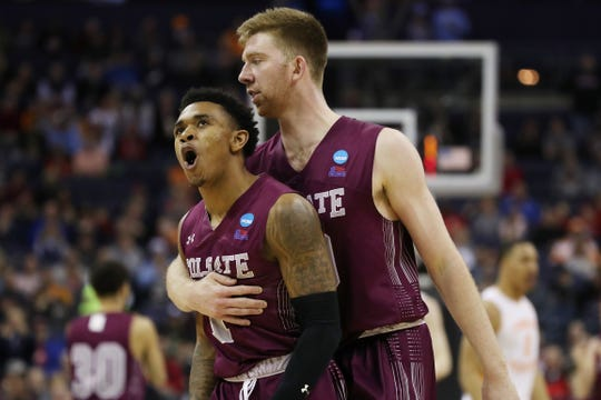 COLUMBUS, OHIO - MARCH 22: Jordan Burns #1 reacts with Will Rayman #10 of the Colgate Raiders during the second half against the Tennessee Volunteers in the first round of the 2019 NCAA Men's Basketball Tournament at Nationwide Arena on March 22, 2019 in Columbus, Ohio. (Photo by Gregory Shamus/Getty Images)