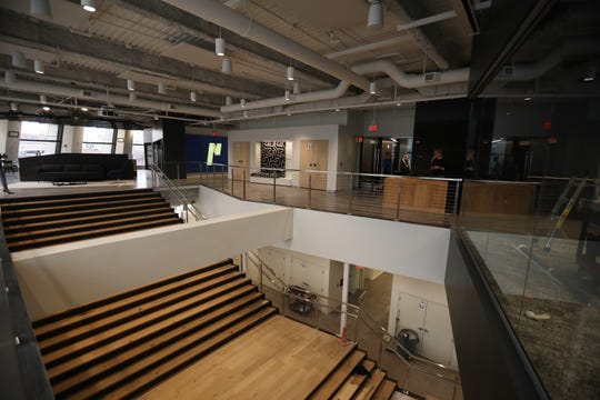 Partners + Napier have moved from the High Falls area to downtown.  Their office is at The Metropolitan, the former Chase Tower.  The stairs are white oak, reclaimed wood from a 100 year old barn in the southern tier.