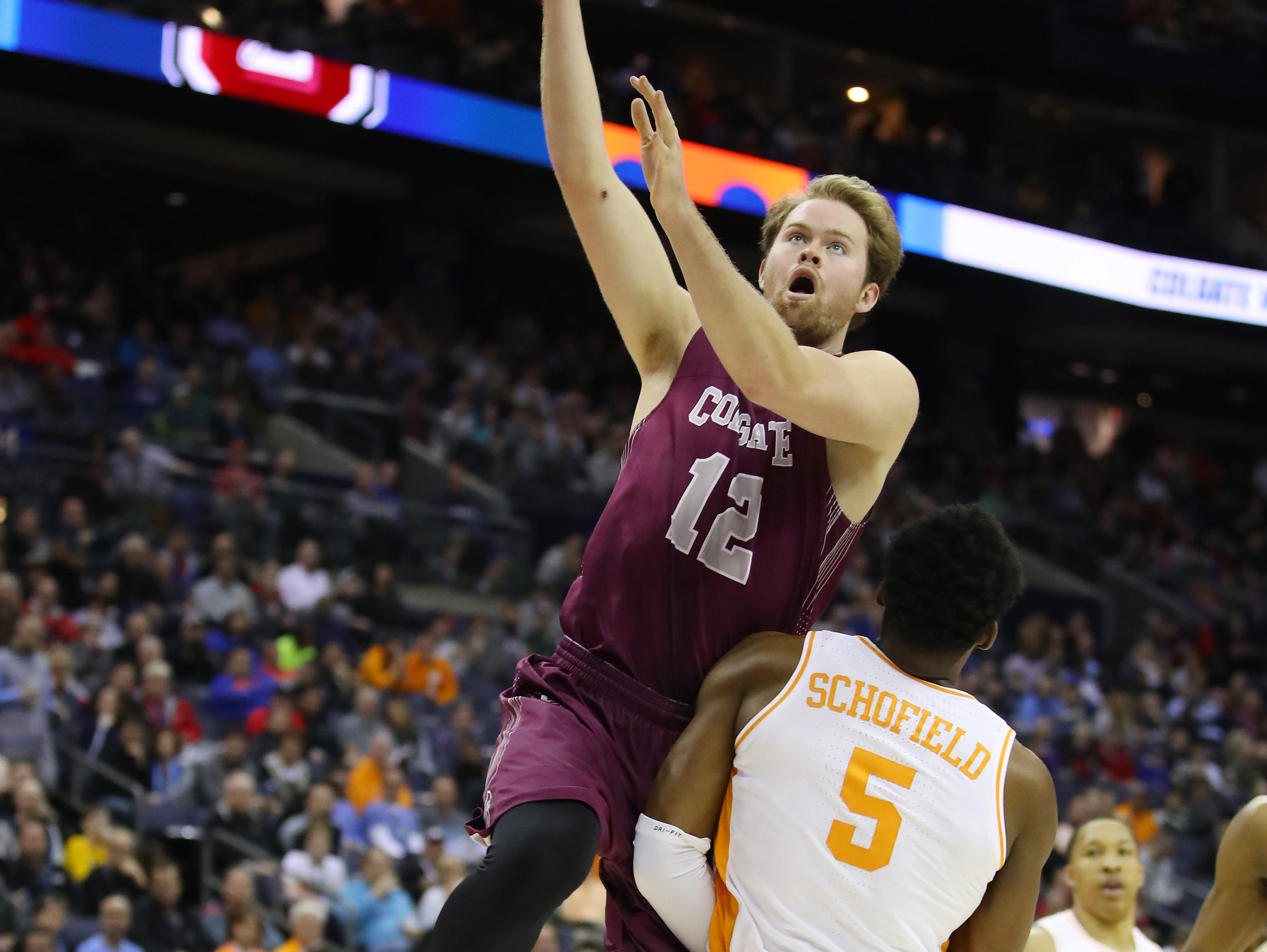 COLUMBUS, OHIO - MARCH 22: Dana Batt #12 of the Colgate Raiders drives to the basket during the first half against the Tennessee Volunteers in the first round of the 2019 NCAA Men's Basketball Tournament at Nationwide Arena on March 22, 2019 in Columbus, Ohio. (Photo by Gregory Shamus/Getty Images)
