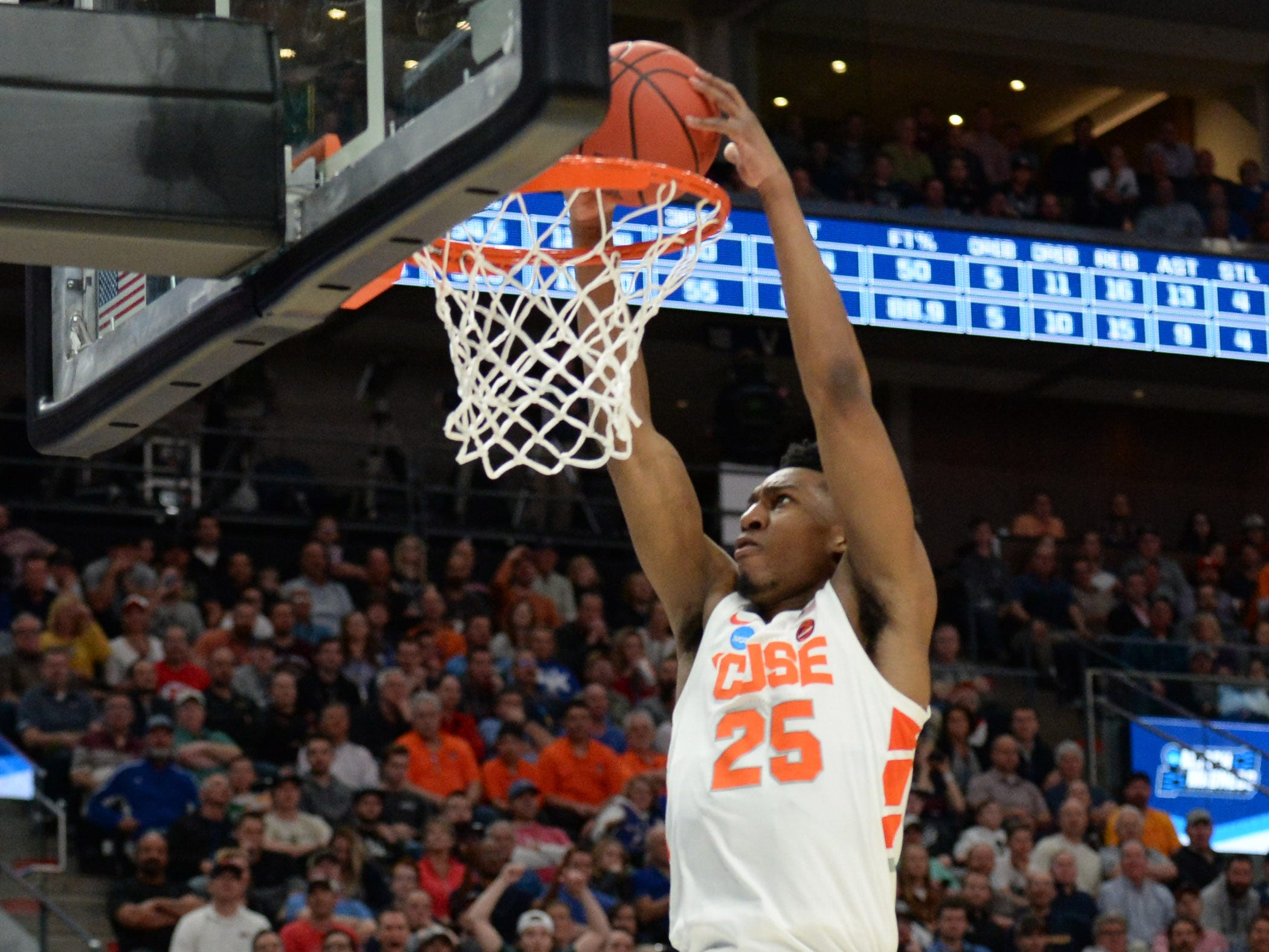 Syracuse Orange guard Tyus Battle (25) dunks the ball against the Baylor Bears during the second half.