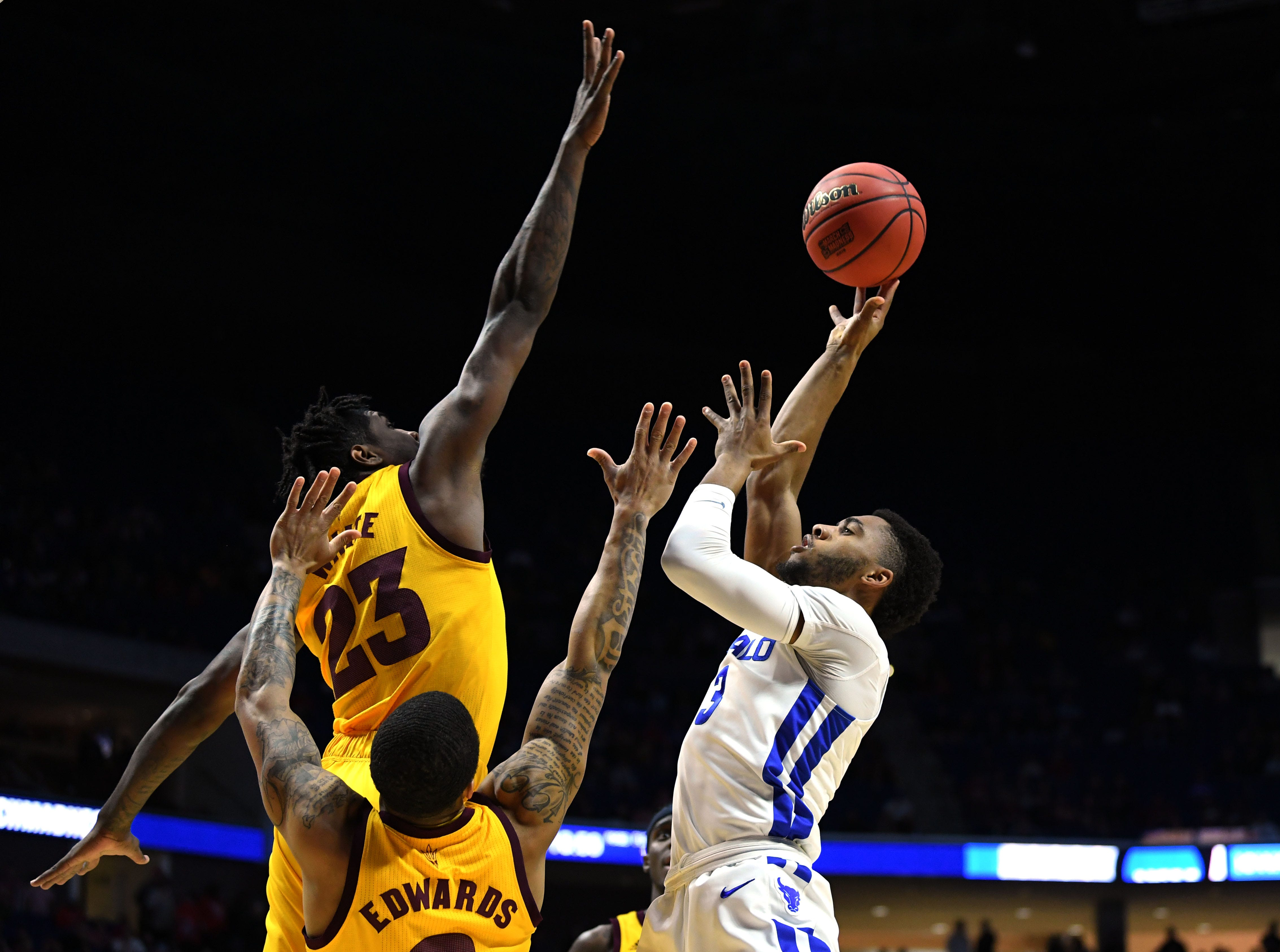 TULSA, OKLAHOMA - MARCH 22:  Jayvon Graves #3 of the Buffalo Bulls attempts a shot over Romello White #23 and Rob Edwards #2 of the Arizona State Sun Devils during the first half of the first round game of the 2019 NCAA Men's Basketball Tournament at BOK Center on March 22, 2019 in Tulsa, Oklahoma. (Photo by Harry How/Getty Images)
