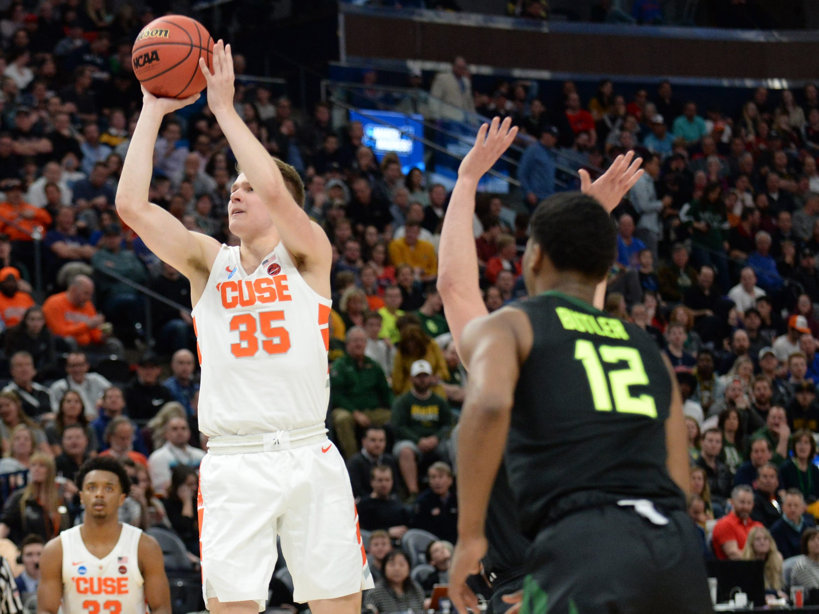 Syracuse  guard Buddy Boeheim (35) shoots against the Baylor Bears during the second half of Thursday night's game in Salt Lake City.