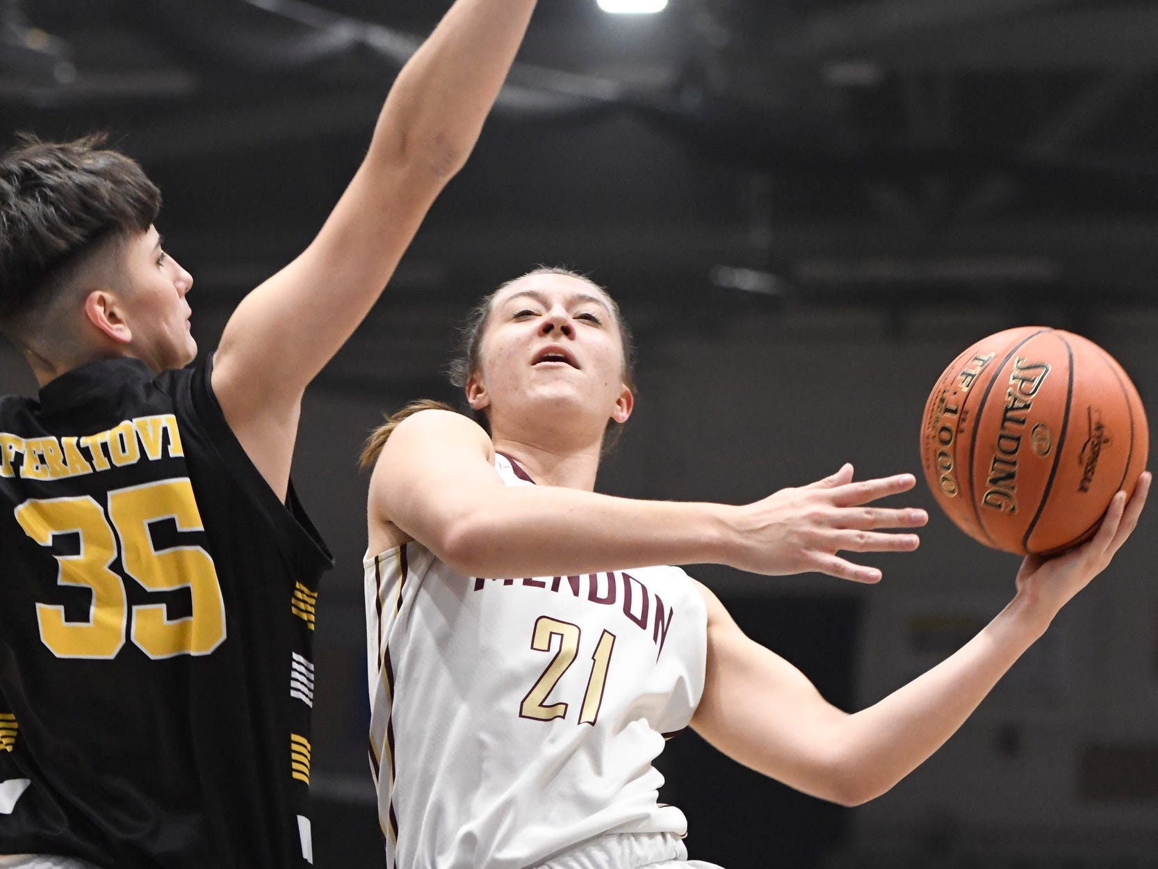 James Madison's Melinda Feratovic attempts to block a shot by Pittsford Mendon's Alana Fursman during their Girls Class A Federation Tournament of Champions semifinal at Cool Insuring Arena on Friday, March 23 in Glens Falls.