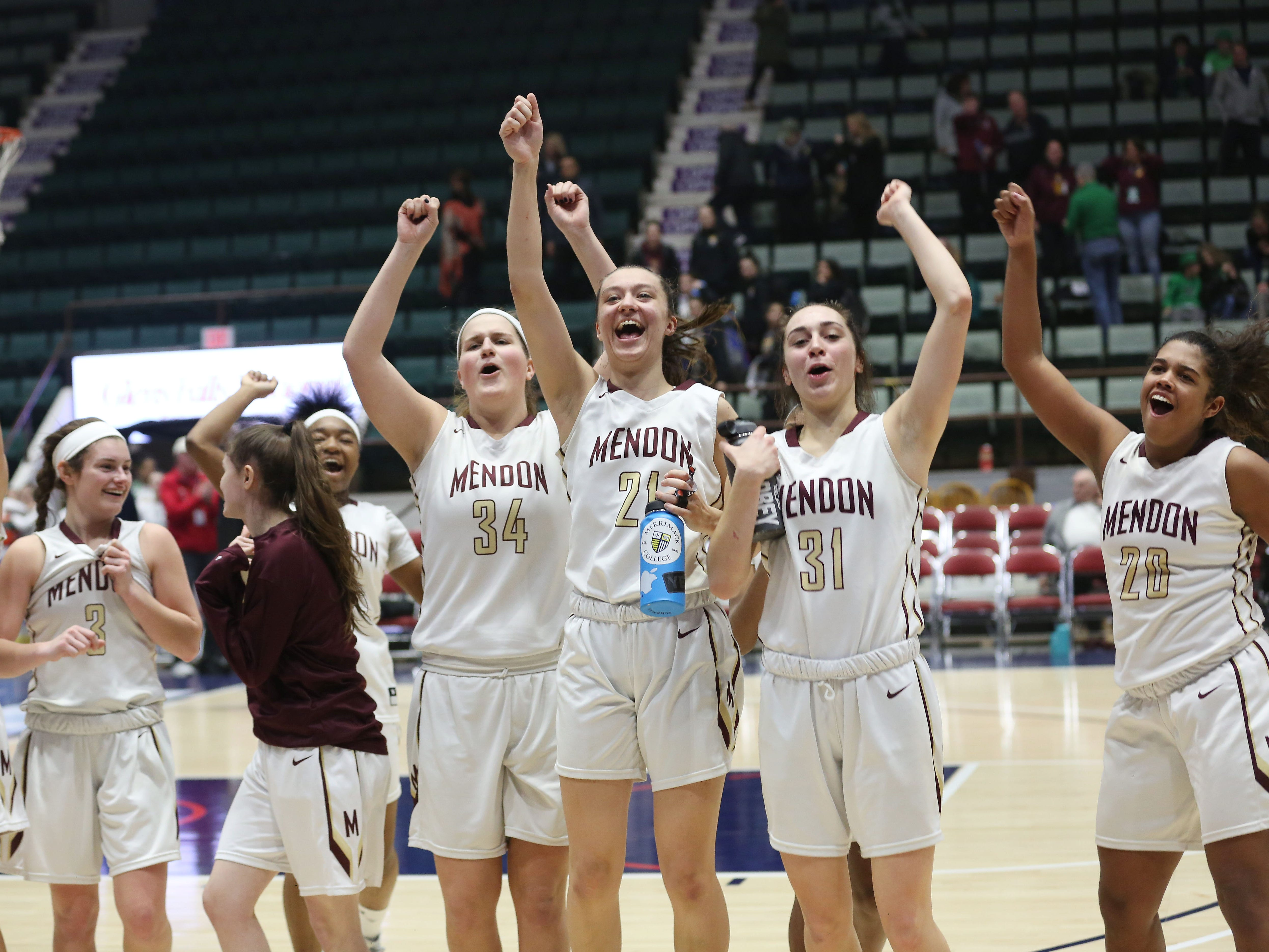 Pittsford Mendon players celebrate their 49-43  victory over James Madison in the girls Class A semifinal in the Federation Tournament of Champions at the Cool Insuring Arena in Glens Falls March 22, 2019. Mendon won the game.