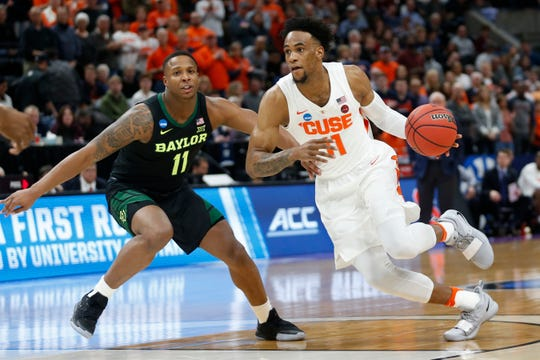 Syracuse forward Oshae Brissett (11) drives as Baylor guard Mark Vital (11) defends during the first half of a first-round game in the NCAA men's college basketball tournament Thursday, March 21, 2019, in Salt Lake City.