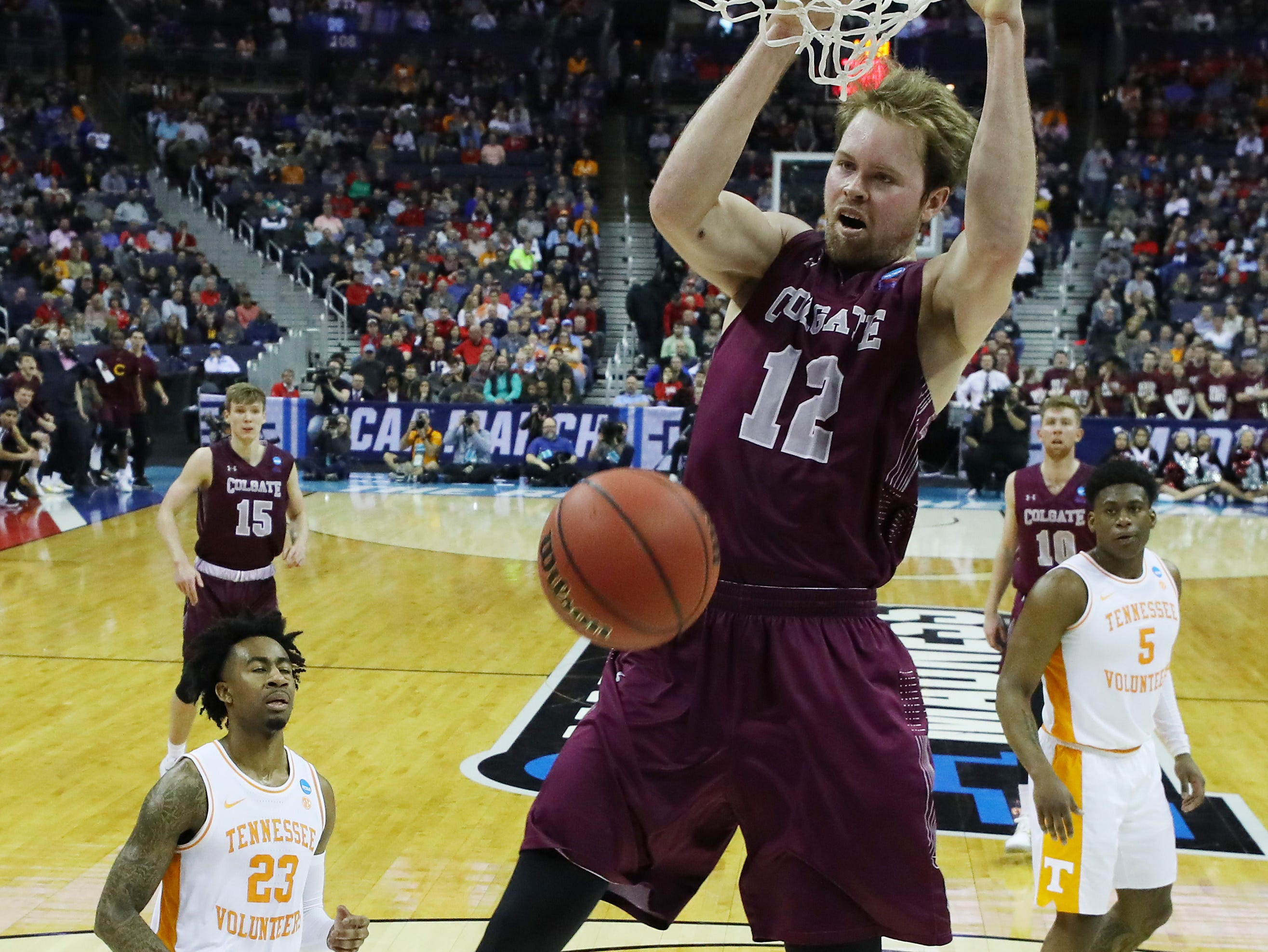 COLUMBUS, OHIO - MARCH 22: Dana Batt #12 of the Colgate Raiders dunks the ball during the first half against the Tennessee Volunteers in the first round of the 2019 NCAA Men's Basketball Tournament at Nationwide Arena on March 22, 2019 in Columbus, Ohio. (Photo by Elsa/Getty Images)