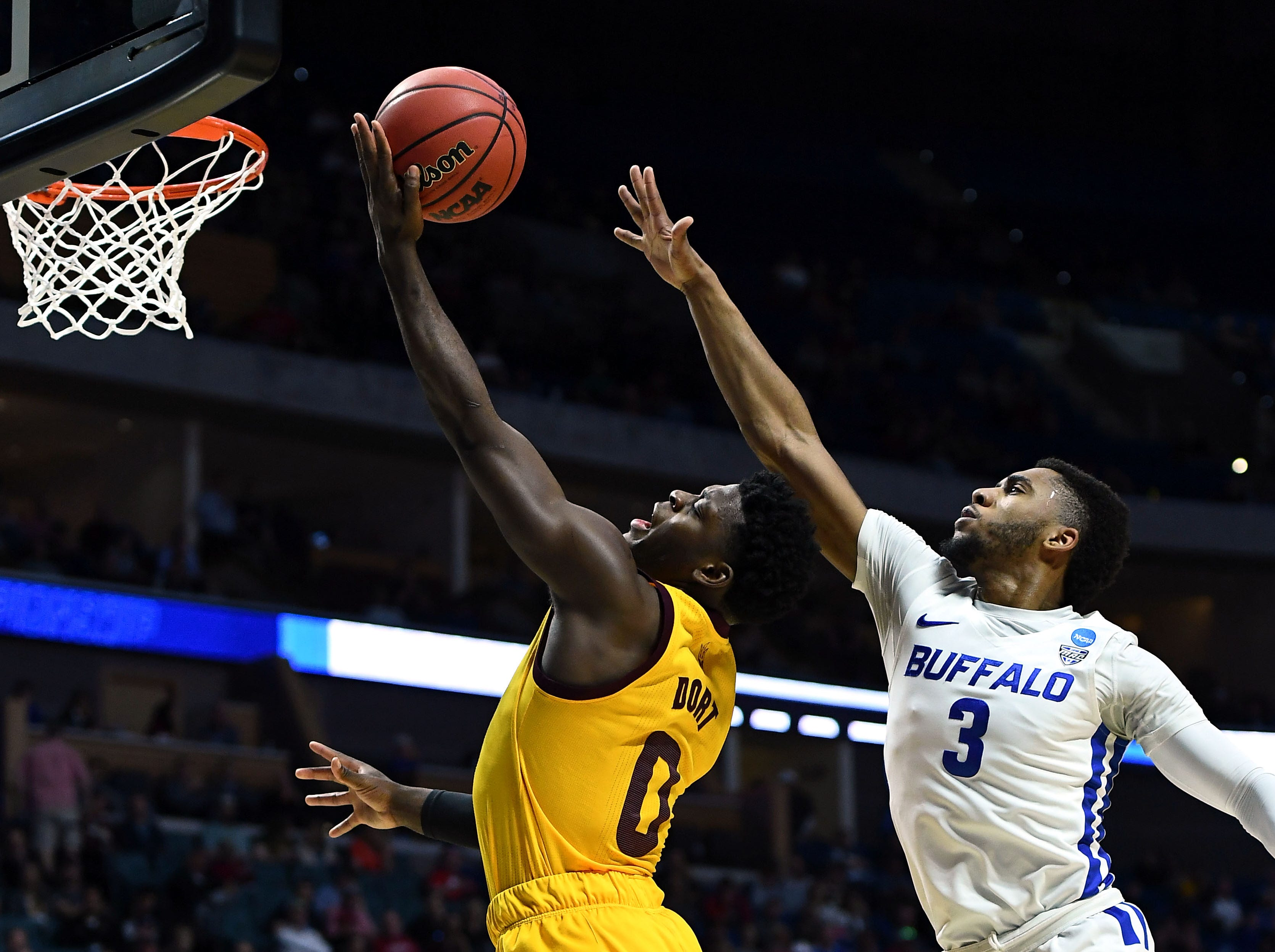 TULSA, OKLAHOMA - MARCH 22: Jayvon Graves #3 of the Buffalo Bulls reaches to block Luguentz Dort #0 of the Arizona State Sun Devils during the first half of the first round game of the 2019 NCAA Men's Basketball Tournament at BOK Center on March 22, 2019 in Tulsa, Oklahoma. (Photo by Stacy Revere/Getty Images)