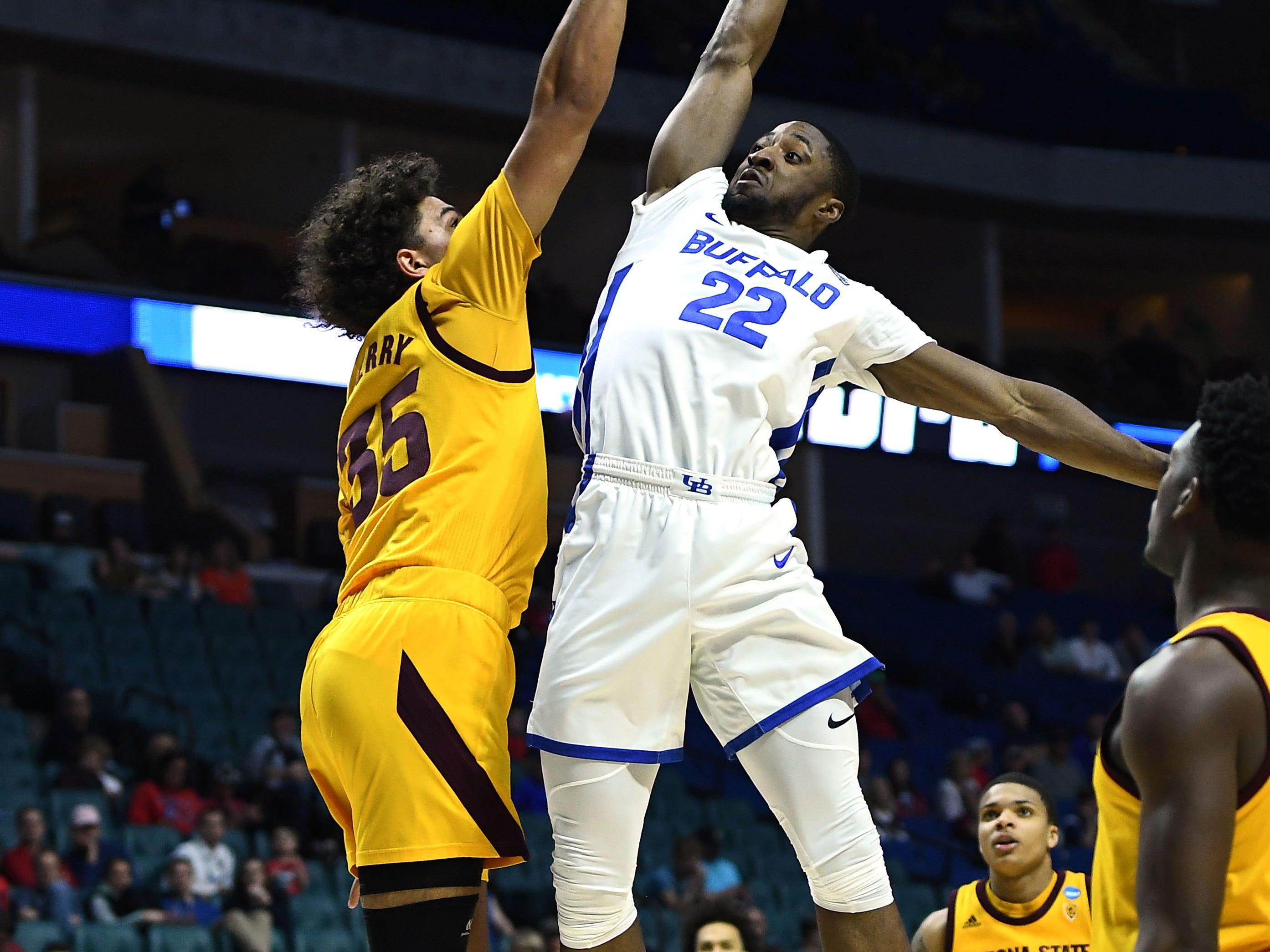 TULSA, OKLAHOMA - MARCH 22:  Taeshon Cherry #35 of the Arizona State Sun Devils blocks a shot by Dontay Caruthers #22 of the Buffalo Bulls during the second half of the first round game of the 2019 NCAA Men's Basketball Tournament at BOK Center on March 22, 2019 in Tulsa, Oklahoma. (Photo by Stacy Revere/Getty Images)