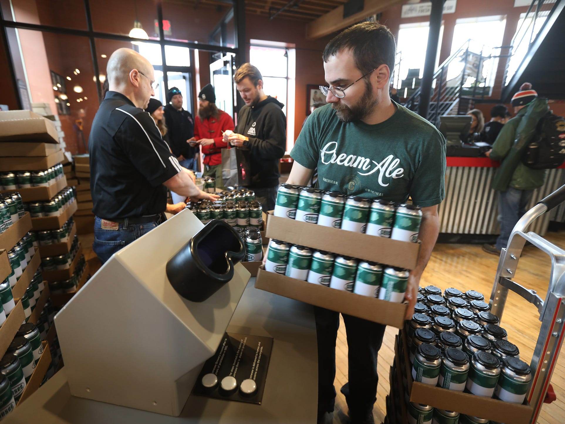 Chris Amico, brings out more cases of Genesee Dream Ale.