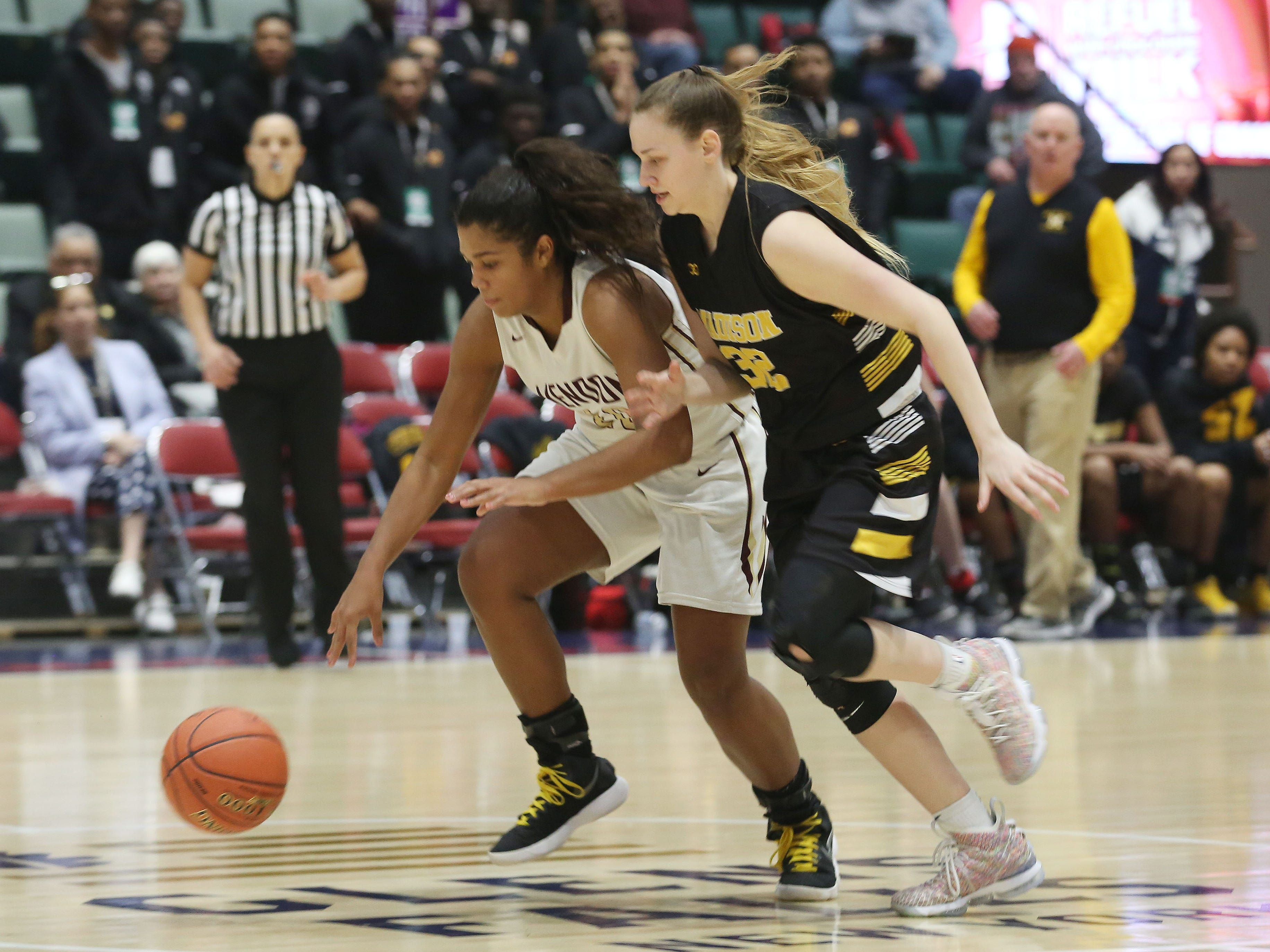 Pittsford Mendon's Lexi Green battles for a loose ball against James Madison during the girls Class A semifinal in the Federation Tournament of Champions at the Cool Insuring Arena in Glens Falls March 22, 2019. Mendon won the game, 49-43